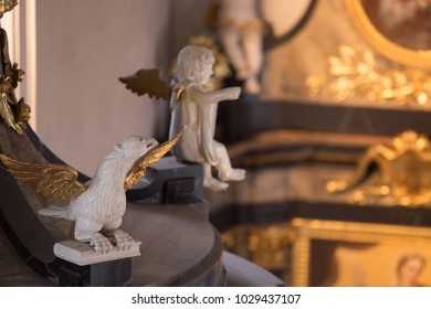 Sculptures of Angels and Eagles in White and Gold in Baroque Church