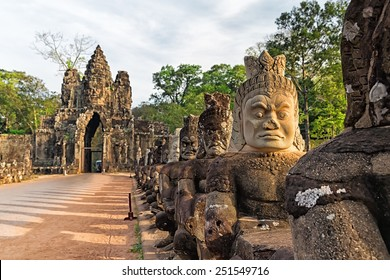 Sculptures of demons of Asia. South gate to Angkor Thom in Cambodia.
