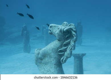 Sculptures and fishes underwater at Green Bay, Cyprus.