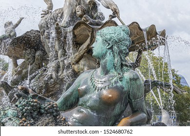 Sculptures fragments of the famous Neptune Fountain (Neptunbrunnen, 1891) in Berlin. Fountain depicting Roman god of water - Neptune. Four women representing main rivers in Prussia. Berlin, Germany.