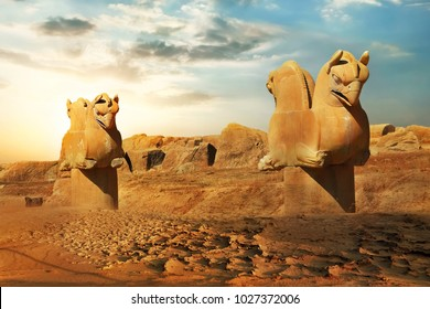 Sculptures of griffins in ancient Persepolis against the backdrop of the rising sun. Iran. Ancient Persia.