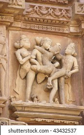Sculptures of loving couples, illustrating the Kama Sutra, on walls of  Kandariya Mahadeva Temple at  Khajuraho in  India, Asia