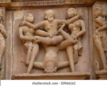 Sculptures of loving couples, illustrating the Kama Sutra, on walls of  Kandariya Mahadeva Temple at  Khajuraho in  India, Asia