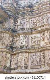 Sculptures of loving couples, maithuna, mythical figures on outer walls of  Visvanatha Temple at  Khajuraho,  India