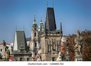 Sculptures on the Charles Bridge, the tower and the church in Prague