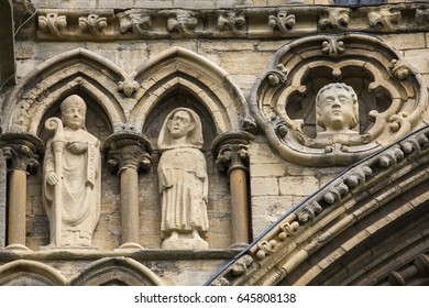 Sculptures on the facade of the historic Peterborough Cathedral in Peterborough, UK.