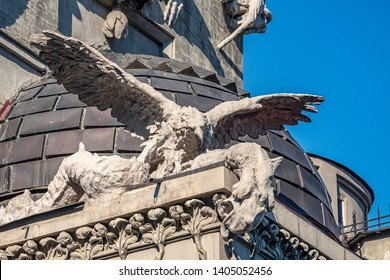 sculptures on the facade of the house with chimeras building across the street from President of Ukraine's office
