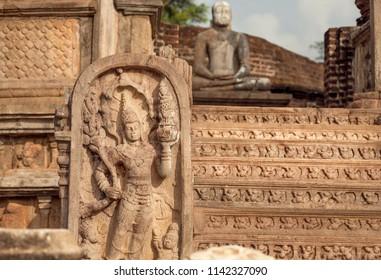 Sculptures and patterns of 12th century stone temple of Buddha. Polonnaruwa, Sri Lanka. UNESCO World heritage Site.