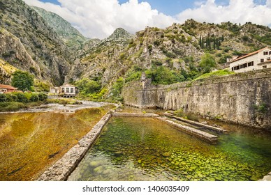 Scurda river and fortification walls in Old Town in Kotor, Montenegro.