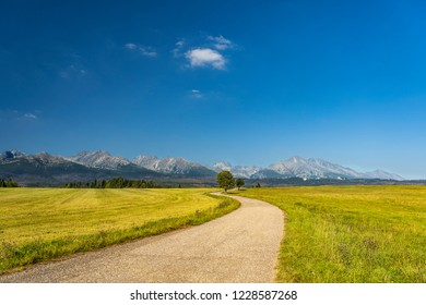 S-curved path to the mountains and hills in High Tatras, Slovakia.