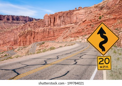 S-Curves Sign:  A sign warns of sharp turns ahead on a road in southern Utah.