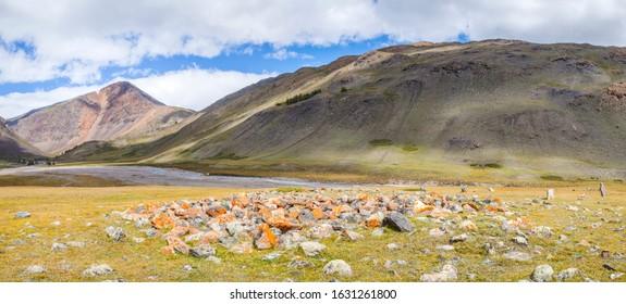 Scythian mound in the Altai mountains. Panoramic view, arid slopes.