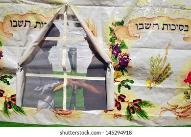 SDEROT, ISR - OCT 10:Israeli men bless on the four species inside a sukkah on Oct 10 2008.Sukkot commemorates the time when the Jews wandered in the desert after the Exodus from Egypt.