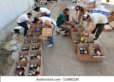 SDEROT - SEPTEMBER 15:Member of Chabad is giving food to poor Jewish families on September 15 2008 in Sderot,Israel.Chabad is an educational organization dedicated to help every Jew in the world.