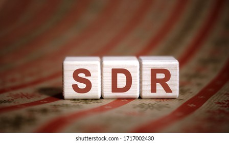 SDR Serpstat Domain Rank - concept on wooden cubes on a striped background