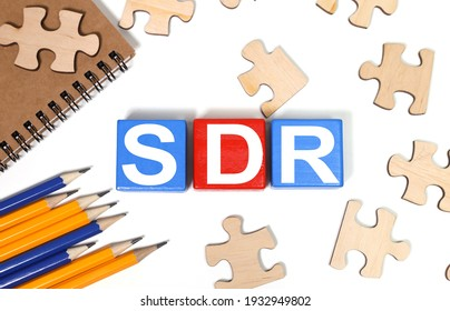 SDR Serpstat Domain Rank - text in black letters on wood blocks