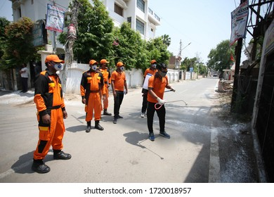 SDRF personnel disinfecting at hotspot area during a government-imposed nationwide lockdown as a preventive measure against the COVID-19 coronavirus, in Prayagraj on May 02, 2020.
