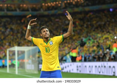 se in Brazil. SAO PAULO, BRAZIL - June 12, 2014: Neymar of Brazil celebrates during the World Cup Group A opening game between Brazil and Croatia at Corinthians Arena. No Use in Brazil.