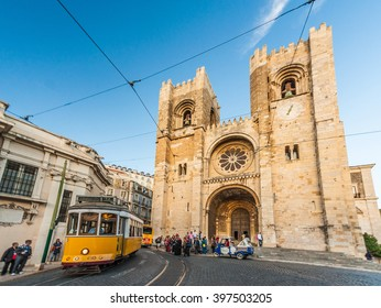 Se (Lisbon Cathedral) with a traditional yellow tram in Lisbon, Portugal