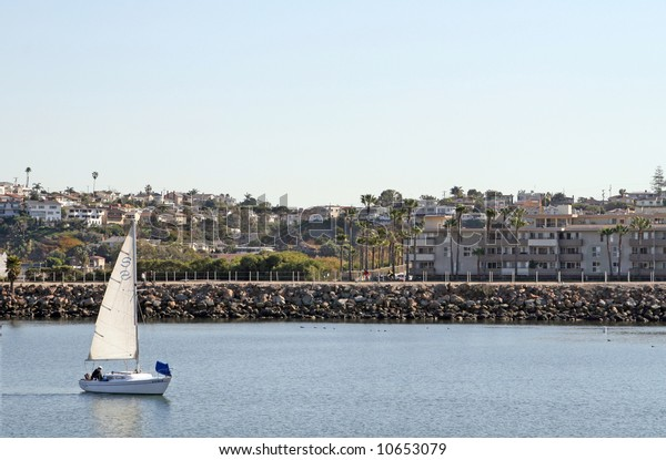 The sea access channel at Marina Del Rey in Los Angeles.  Marina Del Rey is the largest man-made small boat harbor in the world