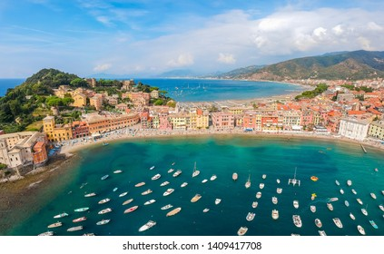 Sea aerial landscape in Sestri Levante, Liguria, Italy. Scenic fishing village with traditional houses and clear blue water. Summer vacation rich resort with picturesque harbour and nice sand beach