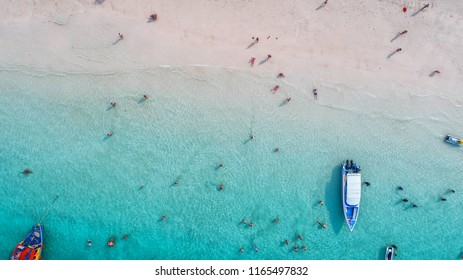 Sea Aerial view and top view, amazing nature background.The color of the water and beautifully bright.Azure beach with rocky mountains and clear water of Thailand ocean at sunny day.