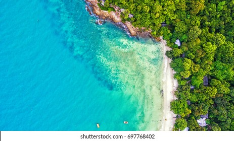Sea Aerial view, Top view,amazing nature background.The color of the water and beautifully bright.Azure beach with rocky mountains and clear water of Thailand ocean at sunny day.from flying drone