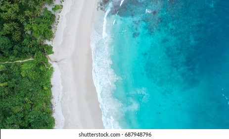 Sea aerial view,Top view,amazing nature background.The color of the water and beautifully bright.Azure beach with rocky mountains and clear water of Thailand ocean at sunny day. Landscape background