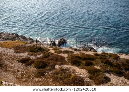 The sea around Europa Point, southern end of Gibraltar. Gibraltar is a British Overseas Territory located on the southern tip of Spain.