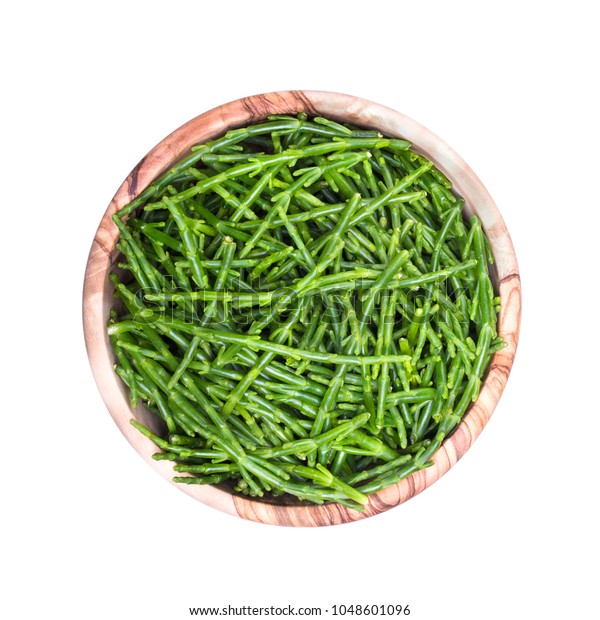 Sea asparagus in a wooden cup on a white background.Salicornia.Top view.