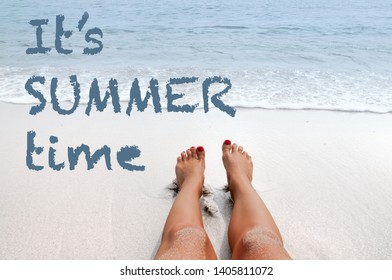 Sea background with lettering it's summer time. Female legs on sandy beach. Vacation on the beach