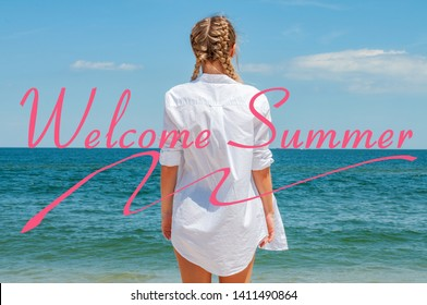 Sea background with letters welcome summer. Beautiful woman in white shirt looking at ocean, on the beach enjoying freedom.