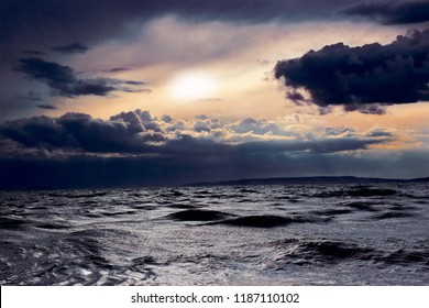 The sea in bad weather with waves, clouds and everything is very dark