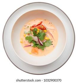 Sea bass ceviche with pumpkin, cilantro, corn and onion, Peruvian food, white background