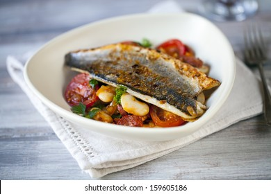Sea bass fillet with butter bean and chorizo salad