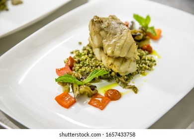 sea bass and radish with dill on a white plate out of focus