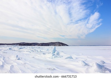 Sea bay covered with snow and ice. Amursky Bay, Primorye, Russia