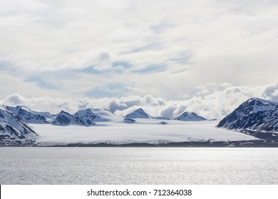 Sea bay with a glacier and icebergs in Svalbard, Spitsbergen, Norway