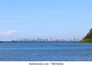 The sea beach with blue sky and cloud and mountains at Pattaya city landmark of Thailand, as nature background.