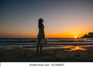 Sea beach girl silhouette, sunset