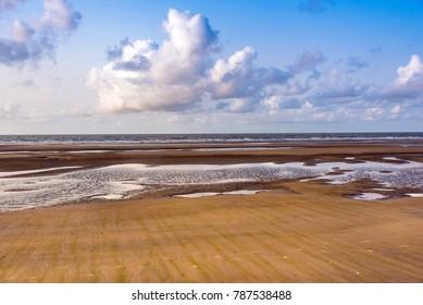 Sea beach on a beautiful sunny day at Mandarmoni on Bay of Bengal.
