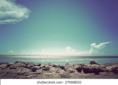 Sea and Beach on white cloud sky background with vintage tone