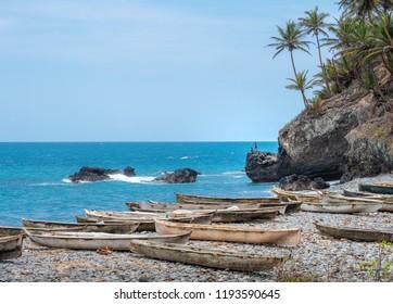 Sea beach Palm tree fishing landscape of Sâo Tomé and Principe. Mountains like Pico Cão Grande. Travel to Sao Tome and Principe. Beautiful paradise island in Gulf of Guinea. Former colony of Portugal