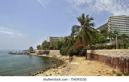 Sea, beach, palm trees, hotels on the sea coast. Spa holidays. Seascape