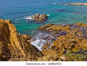 Sea beach with rocks in Lloret de Mar, Spain