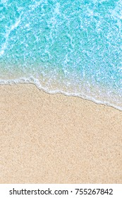 Sea Beach and Soft wave of blue ocean.  Summer vacation and travel concept. Copy space