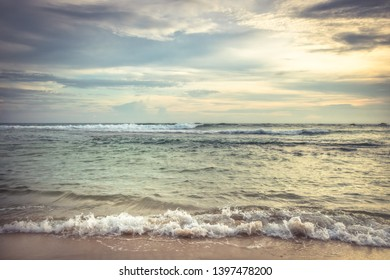 Sea beach surf waves landscape at sunset with dramatic sunset sky natural colors