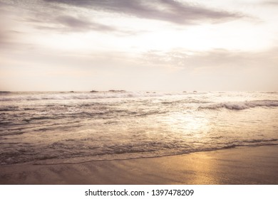 Sea beach surf waves landscape at sunset with dramatic sunset sky vintage style beige colors