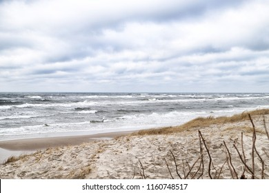 Sea and beach views from the sand dunes of the Curonian spit in a cloudy day. Nida in Lithuania and Kaliningrad region in Russia