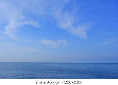 Sea and beautiful blue sky with white cloud.